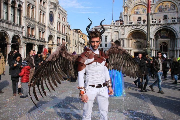 Venice Carnival costumes range from a simple mask to theatrical creations like this!